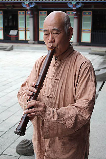 Flute player in Confucius Temple