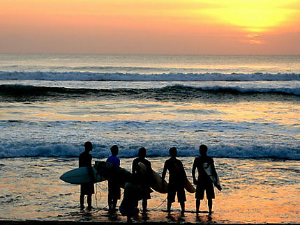 Surfers at sunset