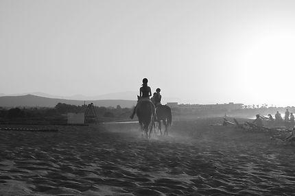Balade à cheval au soleil couchant