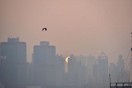 Soleil couchant sur Hong Kong