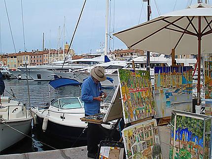 Peintre sur le port