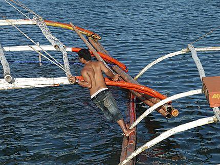 Pêcheur barque à balancier